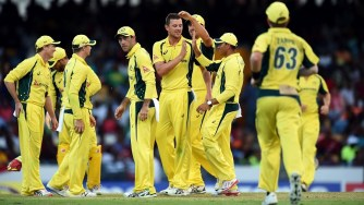 Australian cricketer Josh Hazlewood (C) celebrates with teammates after dismissing West Indies batsman Andre Fletcher during the final match of the Tri-nation Series between Australia and West Indies in Bridgetown on June 26, 2016.   / AFP / Jewel SAMAD        (Photo credit should read JEWEL SAMAD/AFP/Getty Images)