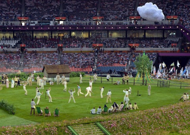 Performers play cricket during the opening ceremony of the London 2012 Olympic Games on July 27, 2012 at the Olympic stadium in London. AFP PHOTO / MARK RALSTON        (Photo credit should read MARK RALSTON/AFP/GettyImages)