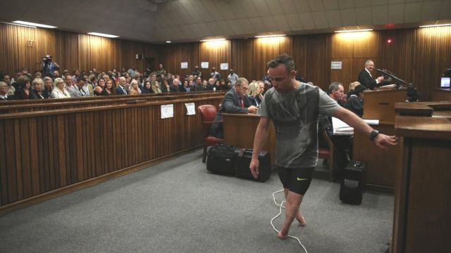 Pistorius walks without prosthetic legs in court to prove his disability (BBC photo)