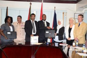 Director of GFSL Delon France receives forensic video analysis equipment and software packages from the Justice Education Society in the presence of Public Security Minister Khemraj Ramjattan and Acting Police Commissioner David Ramnarine.