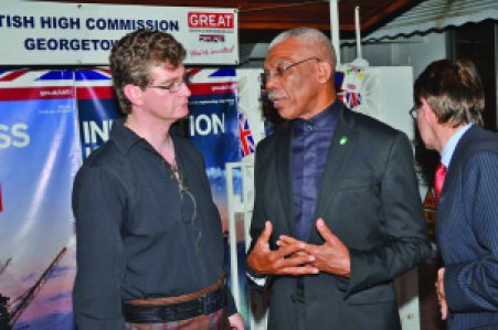 President David Granger makes a point to British High Commissioner to Guyana Greg Quinn at the reception which was held to mark Britain's Queen Elizabeth's 90th birthday