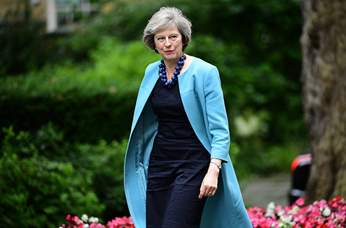 """(FILES) This file photo taken on June 27, 2016 shows British Home Secretary Theresa May walking in Downing Street to attend a cabinet meeting at 10 Downing Street in central London. Theresa May became the sole contender to become Britain's next prime minister on Monday after her sole rival pulled out in a dramatic twist as turmoil sweeps the political scene in the wake of the Brexit vote. Andrea Leadsom, who had come in for heavy criticism after appearing to imply that she was more qualified than May because she had children, said a lengthy leadership race would be """"highly undesirable"""". / AFP PHOTO / LEON NEAL"""