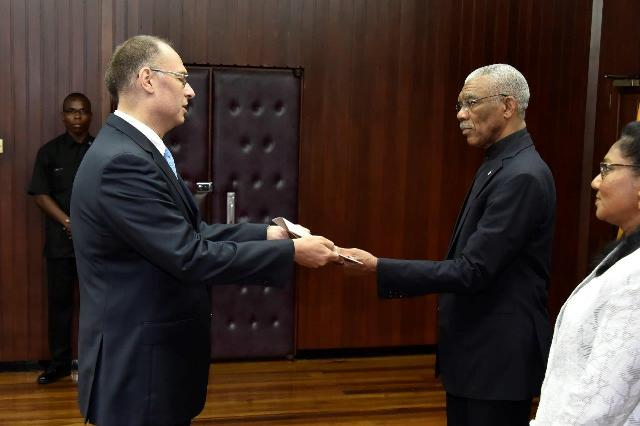 Ambassador Kim Højlund Christensen presents his Letters of Credence to President David Granger at the Ministry of the Presidency  (GINA photo)