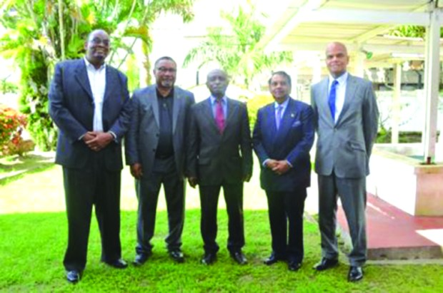 Foreign Affairs Minister Carl Greenidge (centre) flanked by some of the new Heads of Missions (from left to right): Dr Kenrick Hunte, High Commissioner to South Africa; Michael Ten-Pow, Permanent Representative to the UN; Dr Shamir Ally, Head of Mission to Kuwait, and Dr David Pollard, High Commissioner to India