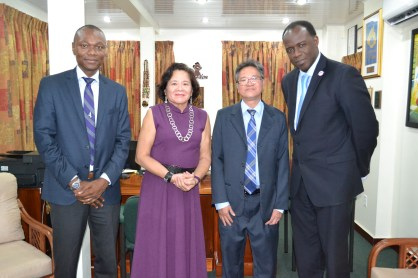 First Lady, Mrs. Sandra Granger is flanked by, from L-R : Mr. Dion Inniss, Caribbean Airlines' Guyana and Suriname Sales Representative; Mr. Tyrone Tang, Chief Executive Officer and Mr. Carl Stuart, South America Manager. (GINA photo)
