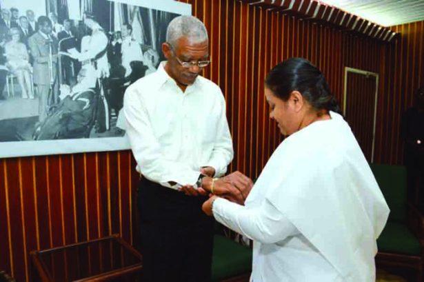 Sister Bharti Khetwani ties a Rakhi or sacred thread on President David Granger's wrist in observance of Raksha Bandhan
