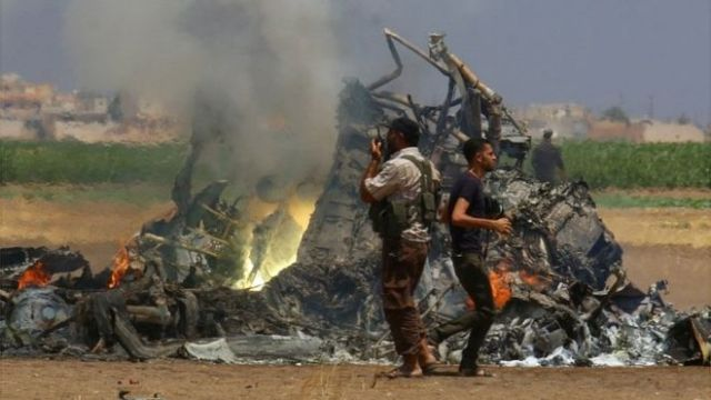 Images appeared online purporting to show burning wreckage from the Russian helicopter (Reuters photo)