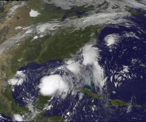 Two Tropical Depressions are shown over the Gulf of Mexico and along the Carolina coast of the United States in this GOES East satellite image captured August 31, 2016.  NOAA/Handout via REUTERS