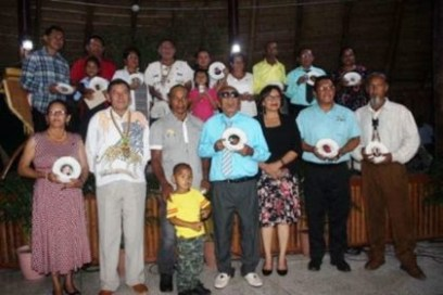 Minister of Indigenous Peoples Affairs Sydney Allicock, (Second left) with Minister within the Ministry of Indigenous Peoples Affairs, Valerie Garrido-Lowe along with the 18 persons who were honored.