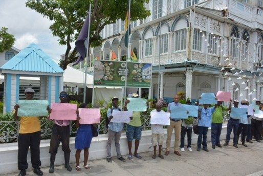 Protesters took to the streets earlier today to call for the removal of Town Clerk, Royston King