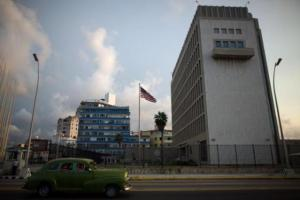 A vintage car passes by the U.S. Embassy in Havana, Cuba, September 21, 2016. REUTERS/Alexandre Meneghini