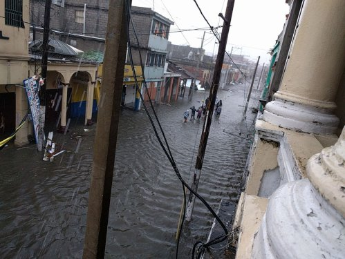 The United Nations mission in Haiti shared a photo of people wading through water in a flooded street there.