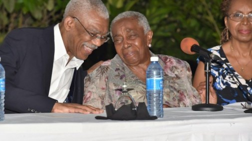 President David Granger and Ms. Carmen Jarvis share a light moment at the event at the Georgetown Club
