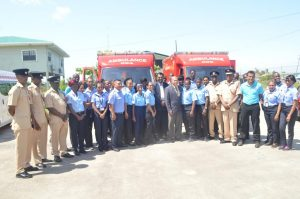 Minister of Public Security, Khemraj Ramjattan and Minister of Public Health, Dr. George Norton (centre) along with members of the Guyana Fire Service, and Emergency Medical Technicians