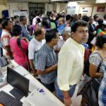 People queued up in banks to withdraw and deposit currency