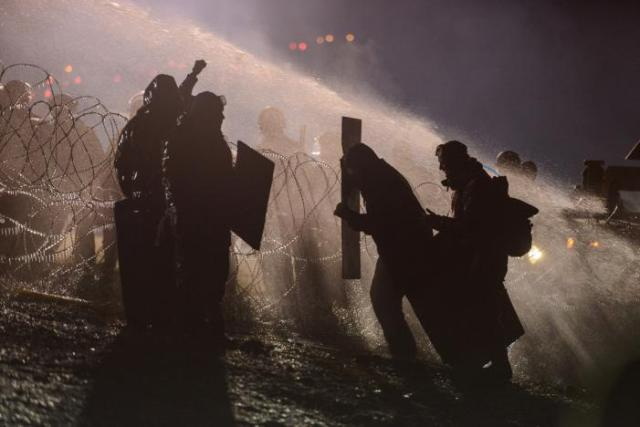 Police use a water cannon on protesters during a protest near the Standing Rock Indian Reservation. REUTERS/Stephanie Keith