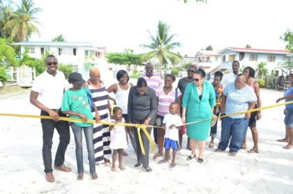 Minister within the Ministry of Education, Nicolette Henry with residents during the ribbon cutting ceremony at the Guyhoc Square area