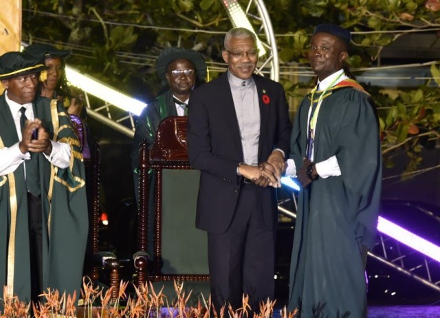 President Granger congratulating the Best Graduating Student, Valedictorian Kibwey Peterkin, minutes after presenting him with the President's Medal