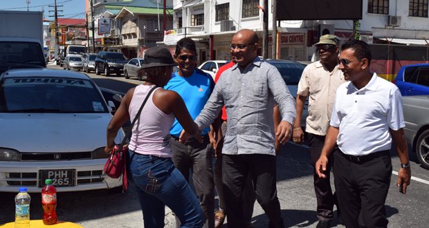 Opposition Leader Dr Bharrat Jagdeo interacting with the 'man in the street' during a walk-about on Saturday