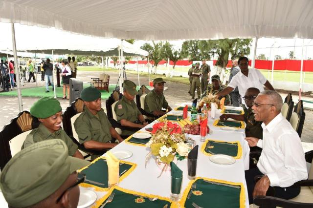 President Granger shares a light moment with some of the Officers of the GDF as Chief of Staff, Brigadier George Lewis looks on.