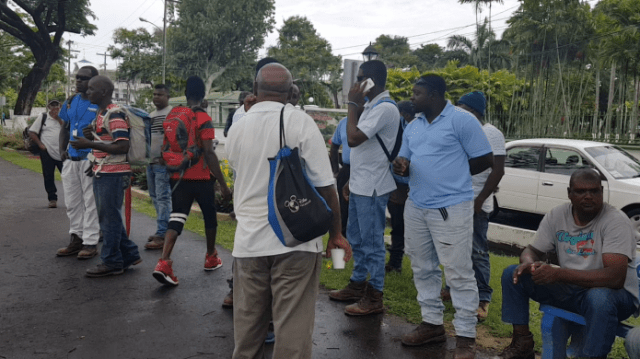 Almost 40 employees gathered in front of the company's Georgetown office, and though they carried no placards, they made the point that the two per cent increase being proposed by GPL will in no way work for them