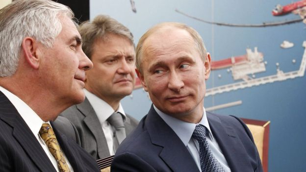 Mr Tillerson (left) pictured meeting Vladimir Putin in 2012