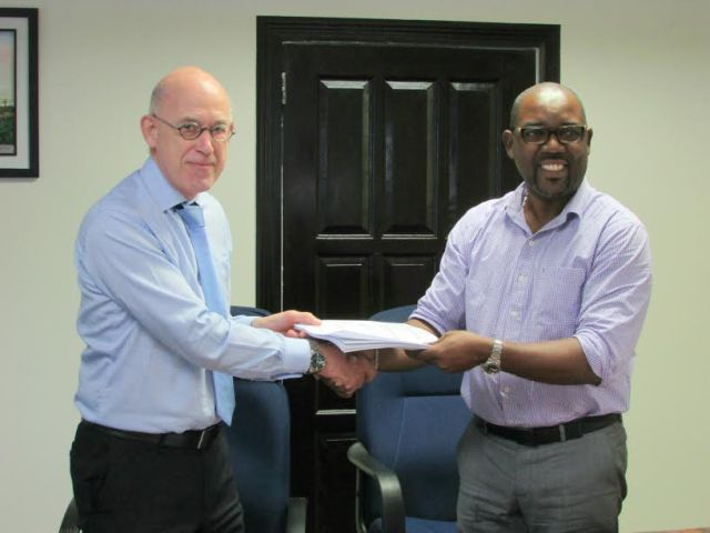 In photo, DHBC General Manager, Mr. Rawlston Adams (right) and Mr. Arie Mol of LievenseCSO (left) shake hands following the signing of the contract.