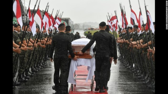 A military guard of honor receives the coffins of members of the Chapecoense soccer team who were killed in a plane crash as they arrive at the airport in Chapeco, Brazil, on Saturday, December 3. The football club was traveling to compete in the Copa Sudamericana final when its charter plane crashed near Medellin, Colombia, on Monday, November 28, killing 71 people on board. Six people survived, including three Chapecoense players.