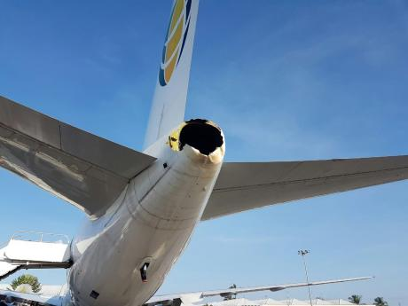 The damaged tail section of the Fly Jamaica Airways aircraft involved in a incident with a Caribbean Airlines plane in Guyana on Tuesday.