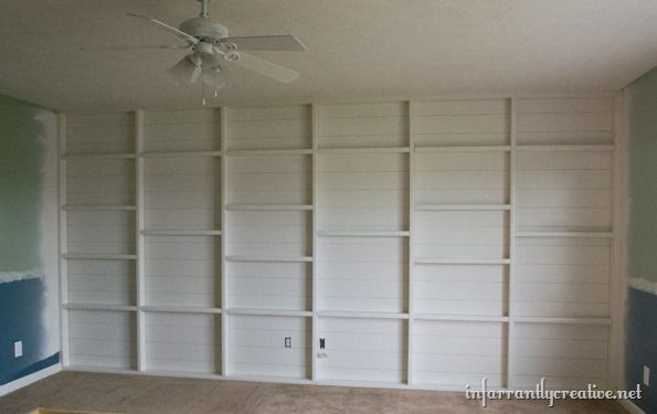 planked and shelved feature wall