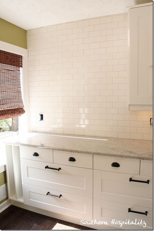 Southern Hospitality putting subway tile on wall
