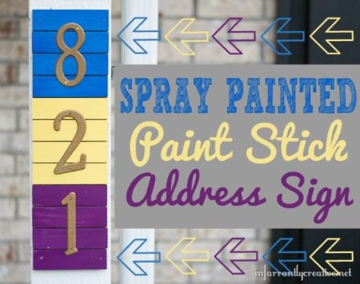 spray painted paint stick address-sign