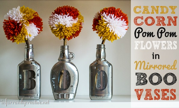 "DIY Halloween Decorations | Candy Corn Pom Pom Flowers in Boo Vases ~ Grab a can of spray paint and upcycle empty glass jars into adorable ""BOO"" vases for Halloween!"
