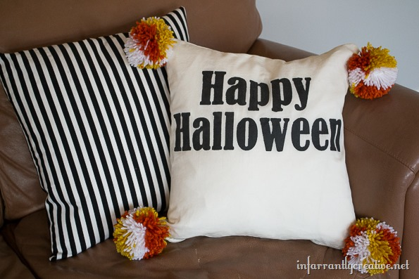 halloween pillow with pom poms