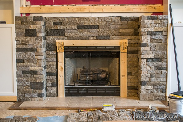built in fireplace with stone