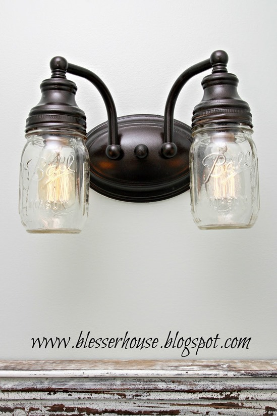 DIY Home Decor ~ Switch out the globes on your bathroom vanity light with mason jars for only $6 in 20 minutes!