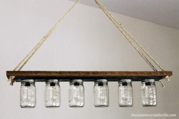 DIY Home Decor ~ Turn a vanity light strip from your bathroom into this gorgeous mason jar chandelier for your dining room!