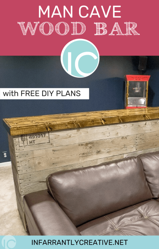 Finished pallet wood bar for your man cave bar area with a couch placed in front of the bar.
