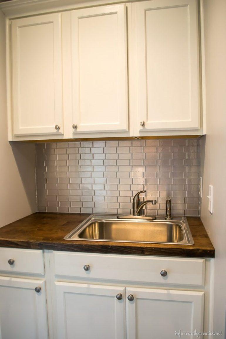 stainless-backsplash-laundry-room