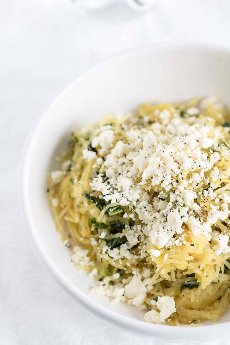 a bowl of spaghetti squash with feta
