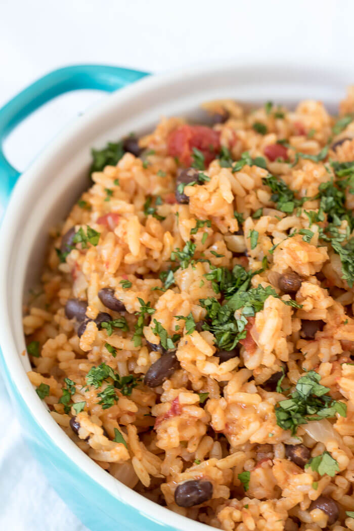 spicy chipotle rice and black beans close up in blue casserole dish