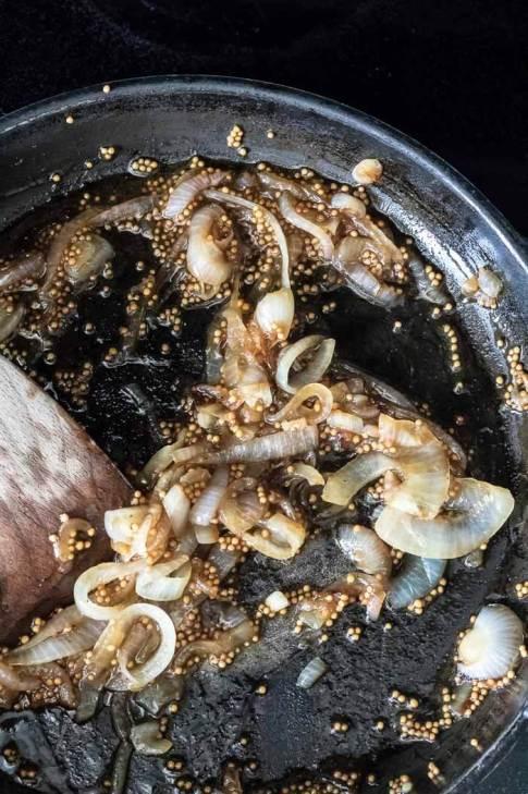 making caramelized onion and mustard vinaigrette for roasted vegetables