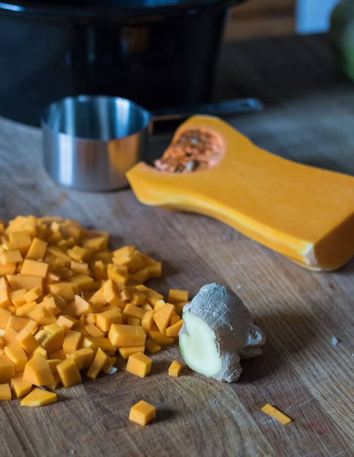 Chopped butternut squash and ginger for chili