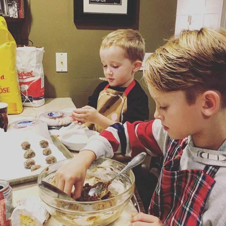 kids helping bake cookies for Christmas