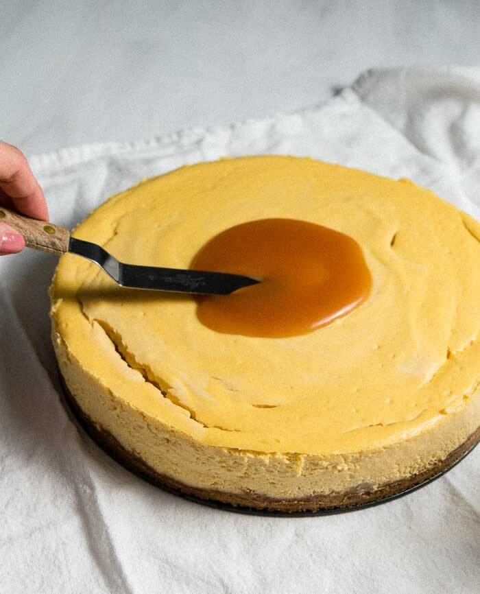 Spreading caramel on banana cheesecake
