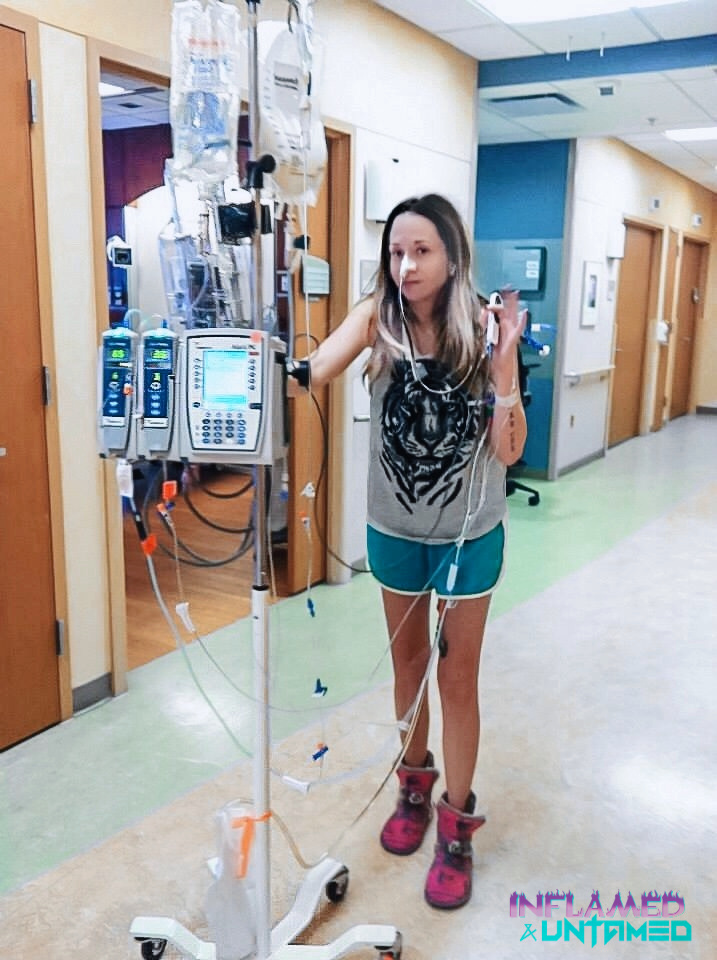 Me walking down the hallway in the hospital pushing my IV pole