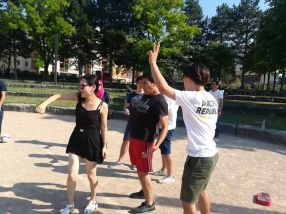 Playing petanque during French summer course in Lyon