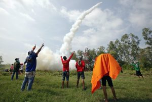 Participants in a rocket competition cheer after their rocket was successfully launched during the rocket festival known as 'Bun Bangfai' in Yasothon, northeast of Bangkok, May 13, 2012 (Photo: Reuters/Chaiwat Subprasom).