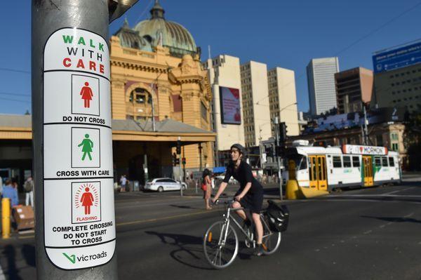 Las instrucciones para los peatones en Melbourne (AFP)