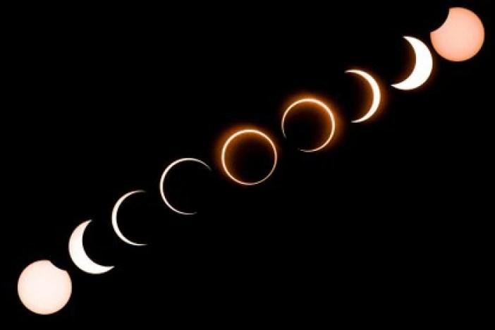 Composición fotográfica del eclipse de 2019 (Photo by Sadiq ASYRAF / AFP)